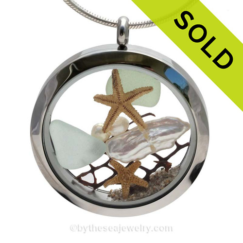Genuine Seafoam sea glass pieces combined with a real baby sandollars, fresh water pearls and genuine stick pearl and real beach sand in this stainless steel locket. SOLD - Sorry this Sea Glass Locket is NO LONGER AVAILABLE