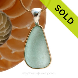 This is a beautiful Paler Aqua Green Genuine Sea Glass set in our Mixed Deluxe Tiffany Wire Bezel© pendant setting.