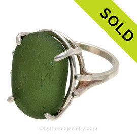 An UNALTERED piece of perfect seaweed green white sea glass set in a solid sterling silver basket ring. SOLD - Sorry this Sea Glass Ring is NO LONGER AVAILABLE!