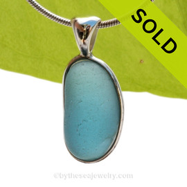 A Lovely Jellybean Shaped Stormy Blue Seaham sea glass set in Sold Sterling Silver Deluxe Wire Bezel© pendant setting. SOLD - Sorry this Rare Sea Glass Pendant is NO LONGER AVAILABLE!