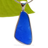 This is a beautiful and LARGE Vivid Cobalt Blue Bottle Bottom Sea Glass Pendant set in our Original Deluxe Wire Bezel© pendant setting in Sterling Silver . The Letters S and A can be visibly seen on the surface of the sea glass.