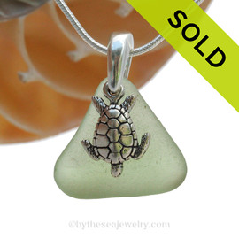 "Peridot Green sea glass set on a solid sterling cast bail with a sterling silver Flip Flop charm. The sea glass necklace comes on our 18"" solid sterling smooth snake chain (SHOWN and included).  SOLD - Sorry this  Sea Glass Necklace is NO LONGER AVAILABLE!"