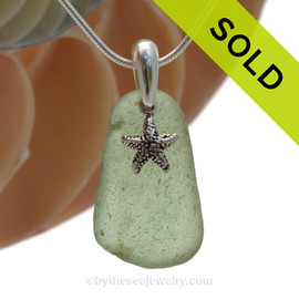 Well Aged Peridot Green sea glass set on a solid sterling cast bail with a sterling silver Starfish charm. SOLD - Sorry this  Rare Sea Glass Necklace is NO LONGER AVAILABLE!
