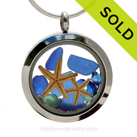 Genuine Cobalt Blue Sea Glass Locket with a two REAL starfish a real beach sand in this stainless steel locket. Finished with a vivid sapphire  crystal gems for a bit of beachy bling. SOLD - Sorry this Sea Glass Locket is NO LONGER AVAILABLE!
