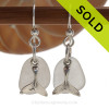 Airy and light pure white sea glass earrings in sterling with sterling lobster charms. A great pair of sea glass earrings for any time of year!