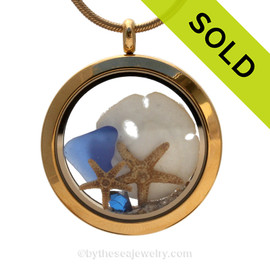 Genuine Blue Sea Glass combined with a baby sandollar crystal gem  and two starfish in this   Goldtone Stainless Steel Locket Necklace. SOLD - Sorry this Sea Glass Locket is NO LONGER AVAILABLE!