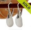 A pair of thicker surf tumbled Genuine Sea Glass Earrings in Pure White on solid sterling leverbacks. SOLD - Sorry these Sea Glass Earrings are NO LONGER AVAILABLE!