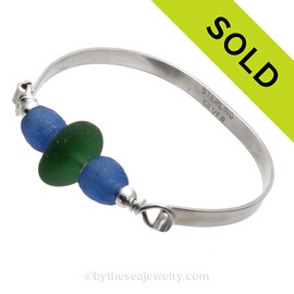 A perfect and round piece of Genuine Seaweed Green Sea Glass with Vivid Blue Recycled Glass Beads on this Solid Sterling Silver thick flat Sea Glass Bangle Bracelet. SOLD - Sorry this Sea Glass Bangle Bracelet is NO LONGER AVAILABLE!
