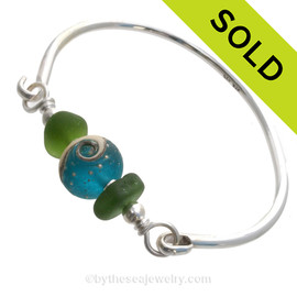Bright Seaweed Green Genuine Sea Glass Bangle Bracelet set with a handmade lampwork glass wave bead set with sterling details on a solid sterling round bangle bracelet. SOLD - Sorry this Sea Glass Bangle Bracelet is NO LONGER AVAILABLE!