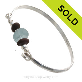 Unusual Gray Blue Genuine English Sea Glass & Natural Beach Stones on this Solid Sterling Silver Half Round Sea Glass Bangle Bracelet. This is finished in solid sterling beads. SOLD - Sorry this Sea Glass Bangle Bracelet is NO LONGER AVAILABLE!