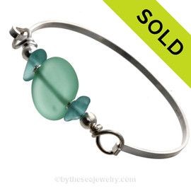 Two nice pieces of aqua green Hawaiian Sea Glass with Vivid Blue lampwork Glass Beads on this Solid Sterling Silver half round Sea Glass Bracelet. SOLD - Sorry this Sea Glass Bracelet is NO LONGER AVAILABLE!