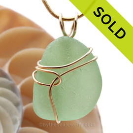 This is authentic natural soft seafoam Green Sea Glass Pendant in our Basic Beach setting in 14K Rolled Gold. A beautiful piece of the is in a secure and simple time tested setting. SOLD - Sorry this Rare Sea Glass Pendant is NO LONGER AVAILABLE!