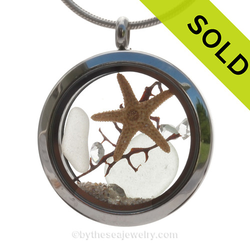 Beautiful pure white sea glass combined in a stainless steel locket necklace with a real starfish, a bit of vintage seafan and clear rystal gems. Finished with real beach sand.  SOLD - Sorry this Sea Glass Locket is NO LONGER AVAILABLE!