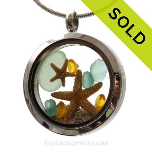 Genuine aqua sea glass pieces combined with a two real starfish and crystal topaz gems stainless steel locket. SOLD - Sorry this Sea Glass Locket is NO LONGER AVAILABLE!