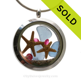Genuine Carolina Blue sea glass pieces combined with a two real starfish and crystal pink tourmaline gem for October stainless steel locket. SOLD - Sorry this Sea Glass Locket is NO LONGER AVAILABLE!