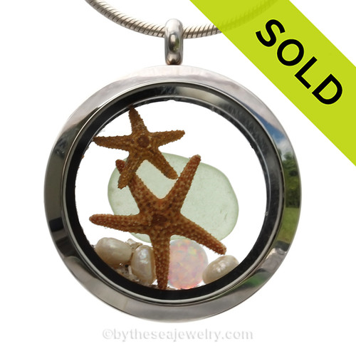 Genuine Soft Seafoam Sea Glass combined with a two real starfish pearls and a simulated Opal for and October stainless steel locket. SOLD - Sorry this Sea Glass Locket is NO LONGER AVAILABLE!!!