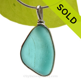 This is our Original Wire Bezel© design that leaves the glass UNALTERED from the way it was found on the beach. Beautiful, Classic and Versatile. SOLD - Sorry this Rare Sea Glass Pendant is NO LONGER AVAILABLE!