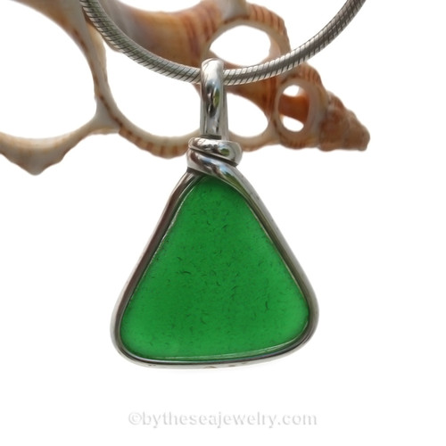 This is a very UNUSUAL triangle of Vivid Emerald Green Sea Glass Jewelry set in our Original Wire Bezel© pendant setting in Sterling Silver . This is our signature Original Wire Bezel© design that leaves the glass UNALTERED from the way it was found on the beach. Beautiful, Classic and Versatile.