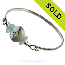 Soft Seafoam Green Genuine sea glass pieces set with a beautiful pastel Wave handmade lampwork glass Wave bead set with sterling details on a solid sterling half round bangle bracelet. SOLD - Sorry this Sea Glass Bangle Bracelet is NO LONGER AVAILABLE!