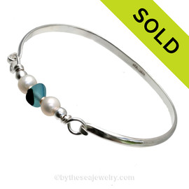A Stunning Aqua and English Multi Sea Glass combined with real cultured pearls on this Solid Sterling Silver Full round Sea Glass Bangle Bracelet. SOLD - Sorry this Sea Glass Bangle Bracelet is NO LONGER AVAILABLE!