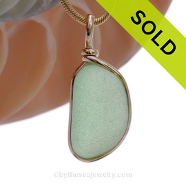 This is a beautiful thick and ROUND Seaham Seafoam Sea Glass set in our Original Wire Bezel© pendant setting with 14K rolled gold.