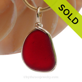 A once in a lifetime piece of large bright cherry  red sea glass is set in our Original Wire Bezel© pendant setting in 14K Goldfilled One of the largest red  sea glass pieces we have ever offered for sale.