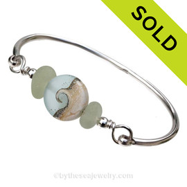 Genuine Seaofam Green Sea Glass Bangle Bracelet set with a handmade lampwork glass wave bead in sof aqua with sterling end beads on a solid sterling full round premium bangle bracelet. SOLD - Sorry this Sea Glass Bangle Bracelet is NO LONGER AVAILABLE!