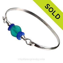 A Vivid Teal handmade Lampwork bead is set between two pieces of Cobalt Blue Sea glass in this Solid Sterling Bangle Bracelet. SOLD - Sorry this Sea Glass Bangle Bracelet is NO LONGER AVAILABLE!