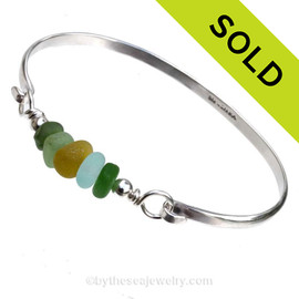 5 Pieces of Genuine Sea Glass on this Solid Sterling Half Round Bangle Bracelet. SOLD - Sorry this Sea Glass Bangle Bracelet is NO LONGER AVAILABLE!