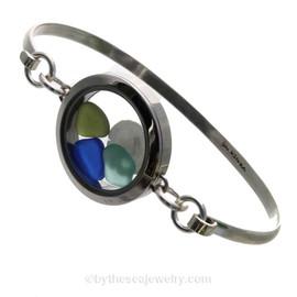 Genuine Sea Glass Locket Bracelet A single piece of seafoam green , blue and aqua sea glass a real sandollar in this one of a kind sea glass bangle bracelet!