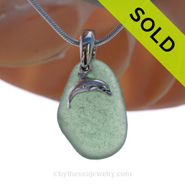 Genuine Unusual green Sea Glass Necklace with Beach found Sea Glass Necklace with a Solid Sterling Dolphin Charm and Solid Sterling Silver Snake chain. SOLD - Sorry this Sea Glass Necklace is NO LONGER AVAILABLE!