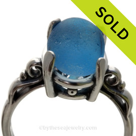Gorgeous Mixed Blue Sea Glass Ring in a Solid Sterling Silver Scroll setting.