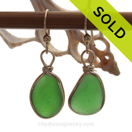 Natural Genuine UNALTERED sea glass pieces in a Vivid Green xpertly wrapped in 14K Rolled Gold for a lovely classic pair or earrings!