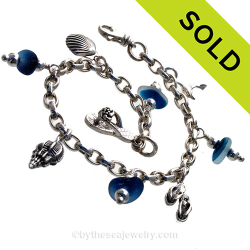 4 pieces of flashed RARE Vivid Aqua Blue Genuine beach found Sea Glass on a totally Solid Sterling Silver Charm Bracelet. The bracelet is made of top quality SOLID STERLING seamless Oval Rolo 5.3 MM links and has FULLY Soldered Utility Links for a lifetime of surety!  SOLD - Sorry this Sea Glass Charm Bracelet is NO LONGER AVAILABLE!