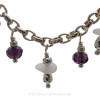Stunning vintage crystal beads compliment the genuine purple sea glass Pieces.