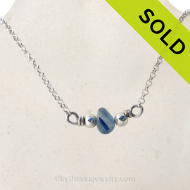 Simple petite Medium Mixed Blue Seaham Sea Glass on a small Rolo chain with Dolphin clasp.