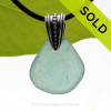 A large piece of vivid Aqua Blue sea glass from Spain set  on a Sterling bail with Black Neoprene Cord. SOLD - Sorry this Sea Glass Necklace is NO LONGER AVAILABLE!