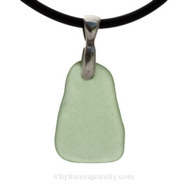 A Prefect piece of vivid Sea Green  sea glass from set  on a Sterling bail with Black Neoprene Cord