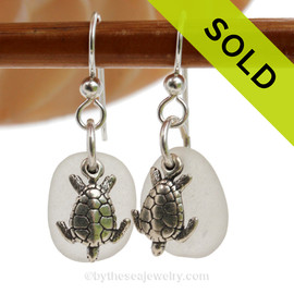 Natural pure white sea glass pieces are set with solid sterling sea turtle charms and are presented on sterling silver fishook earrings. SOLD - Sorry these Sea Glass Earrings are NO LONGER AVAILABLE!