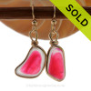 Two vivid pink sea glass that originated as scrap art glass set in our 14K Rolled Gold Original Wire Bezel© setting that leaves the sea glass UNALTERED from the way it was found on the beach.