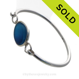 Genuine Sea Glass Bangle Bracelet in a ELECTRIC Mixed Aqua Blue set in our Deluxe Wire Bezel© sterling silver setting.