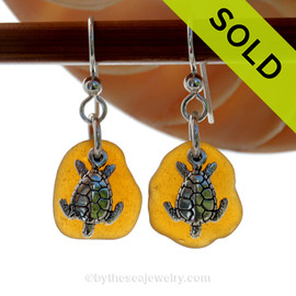 Natural amber sea glass pieces are set with solid sterling sea turtle charms and are presented on sterling silver fishook earrings. SOLD - Sorry these Sea Glass Earrings are NO LONGER AVAILABLE!