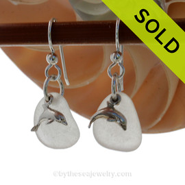 Airy and light pure white sea glass earrings in sterling with sterling dolphin charms.