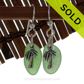 Beach found green sea glass pieces are set with solid sterling pal tree charms and are presented on sterling silver fishook earrings. SOLD - Sorry these Sea Glass Earrings are NO LONGER AVAILABLE!