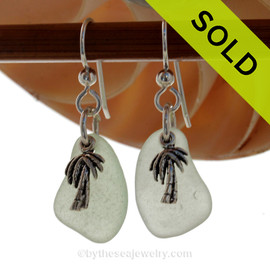Beach found seafoam green sea glass pieces are set with solid sterling palm tree charms and are presented on sterling silver fishook earrings. SOLD - Sorry these Sea Glass Earrings are NO LONGER AVAILABLE!