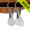 A pair of surf tumbled Genuine Sea Glass Earrings in White on solid sterling leverbacks.