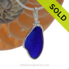 A stunning piece of Rich Cobalt Blue Genuine Sea Glass  bottle bottom with in our signature Original Wire Bezel© pendant setting in Sterling Silver. SOLD - Sorry this Rare Sea Glass Pendant is NO LONGER AVAILABLE!