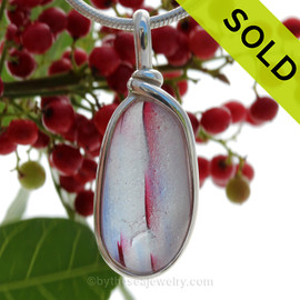 A vivid mix of hot pink and subtle blue streaks in this in a base of pure white endoday sea glass from England set in our Original Wire Bezel© necklace pendant setting. SOLD - Sorry this Ultra Rare Sea Glass Pendant is NO LONGER AVAILABLE!