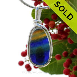 A vivid mix of electric golden yellow, green and blue in this in a base of pure white endoday sea glass from England set in our Original Wire Bezel© necklace pendant setting. SOLD - Sorry this Rare Sea Glass Pendant is NO LONGER AVAILABLE!