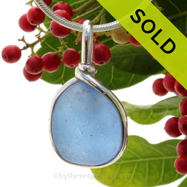 This is a beautiful VERY LARGE Perfect Carolina Blue Sea Glass set in our Original Wire Bezel© pendant setting  in Solid Sterling Silver.
